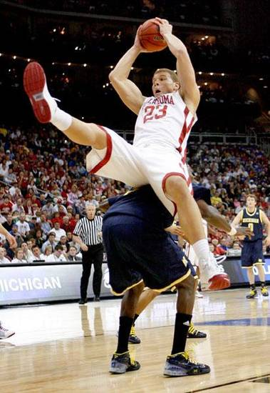 OU's Blake Griffin lands on Michigan's Manny Harris during a second-round men's NCAA college basketball tournament game between Oklahoma and Michigan in Kansas City, Mo., Saturday, March 21, 2009. PHOTO BY BRYAN TERRY, THE OKLAHOMAN