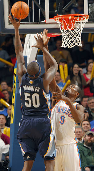 The Thunder's Serge Ibaka (9) defends on Memphis' Zach Randolph (50) during the NBA basketball game between the Oklahoma City Thunder and the Memphis Grizzlies at the Oklahoma City Arena on Tuesday, Feb. 8, 2011, Oklahoma City, Okla.