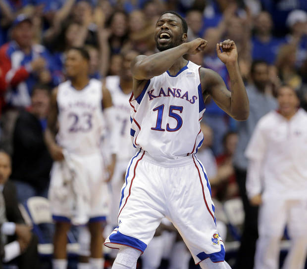 Kansas guard Elijah Johnson (15) celebrates after a basket during the first half of an NCAA college basketball game against Belmont, Saturday, Dec. 15, 2012, in Lawrence, Kan. (AP Photo/Charlie Riedel) ORG XMIT: KSCR104