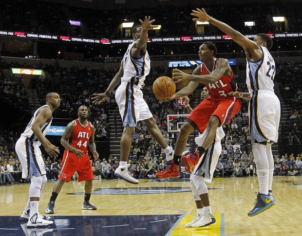 Atlanta Hawks guard Louis Williams (3) goes to the basket between Memphis Grizzlies guard Tony Allen (9) and forward Rudy Gay (22) in the first half of an NBA basketball game on Saturday, Dec. 8, 2012, in Memphis, Tenn. (AP Photo/Lance Murphey)