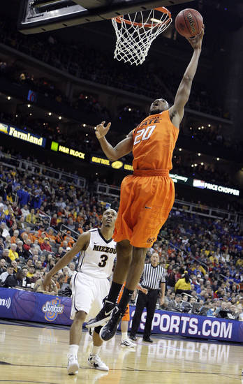 Oklahoma's Michael Cobbins (20) shoots a lay up in front of Missouri's Matt Pressey (3) during the Big 12 tournament men's basketball game between the Oklahoma State Cowboys and Missouri Tigers the Sprint Center, Thursday, March 8, 2012.   Photo by Sarah Phipps, The Oklahoman