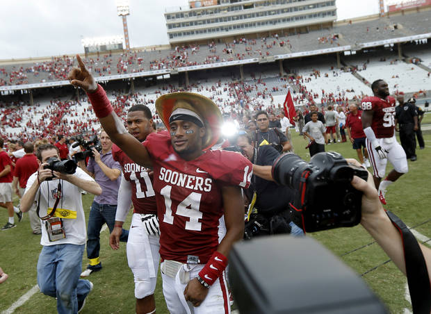 OU&#039;s Aaron Colvin (14) celebrates after the Red River Rivalry college football game between the University of Oklahoma (OU) and the University of Texas (UT) at the Cotton Bowl in Dallas, Saturday, Oct. 13, 2012. Oklahoma won 63-21. Photo by Bryan Terry, The Oklahoman