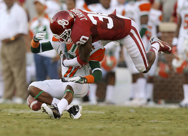 Oklahoma's Javon Harris (30) knocks a pass away from Florida A&M's  Anthony Williams (11) during the college football game between the University of Oklahoma Sooners (OU) and Florida A&M Rattlers at Gaylord Family�Oklahoma Memorial Stadium in Norman, Okla., Saturday, Sept. 8, 2012. Photo by Bryan Terry, The Oklahoman