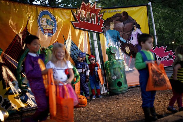 Gabriel Sanchez, 5, left, and Ramon Sanchez, 4, of Oklahoma City stand in front of a backdrop for a photo during Haunt The Zoo at the Oklahoma CIty Zoo on Wednesday, October 31, 2012. Photo by Bryan Terry, The Oklahoman