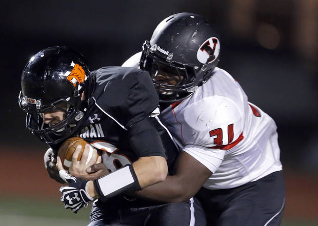 Norman's Zach Long is tackled by Yukon's Andre Dowuona Hammond during the high school football game between Norman and Yukon at Norman High School in Norman, Okla., Thursday, Nov. 8, 2012. Photo by Sarah Phipps, The Oklahoman