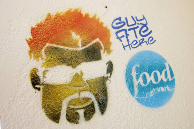 Guy Fieri logo on the wall inside Nic's Grill, 1201 N Pennsylvania, in Oklahoma City Friday, August 21, 2009.  Photo by Paul B. Southerland, The Oklahoman ORG XMIT: KOD