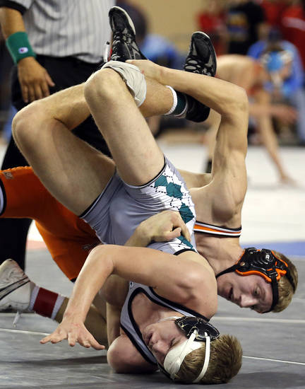 Cushing's Ryan Moline wrestles  Catoosa's, front, Darren Fowler in the 4A 145-pound semifinal wrestles during the state wrestling tournament at the State Fair Arena in Oklahoma City,  Friday, Feb. 22, 2013. Photo by Sarah Phipps, The Oklahoman