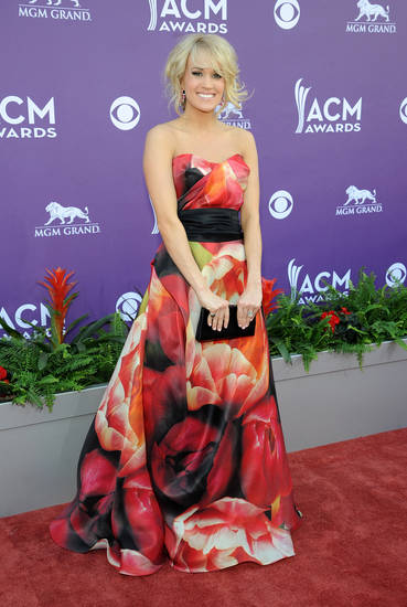 Singer Carrie Underwood arrives at the 48th Annual Academy of Country Music Awards at the MGM Grand Garden Arena in Las Vegas on Sunday, April 7, 2013. (Photo by Al Powers/Invision/AP) ORG XMIT: NVPM163 <strong>Al Powers - Al Powers/Invision/AP</strong>