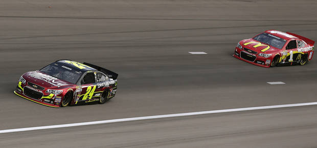 Jeff Gordon (24) and Jamie McMurray (1) make their way around turn four during practice for the NASCAR Sprint Cup Series race, Saturday, March 9, 2013 in Las Vegas. (AP Photo/Julie Jacobson)