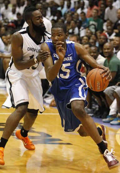 Oklahoma City Thunder's Kevin Durant, right, playing for Goodman League, drives on Thunder teammate James Harden, left, playing for Drew League, during an all-star basketball game at Trinity University in Washington, Saturday, Aug. 20, 2011. (AP Photo/Charles Dharapak) ORG XMIT: DCCD103