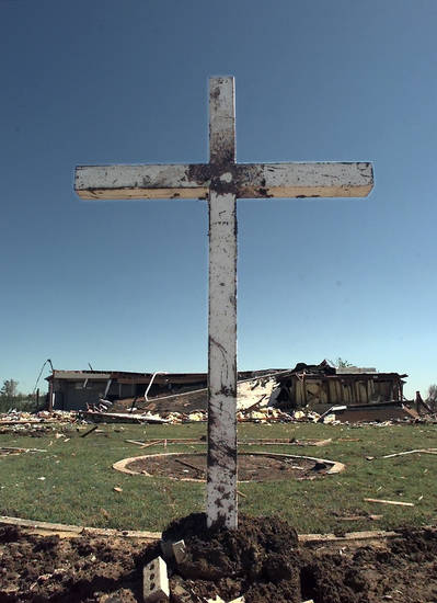 Tornado damage: Cross replanted in front of Sooner Baptist Church at 5824 SE 15.
