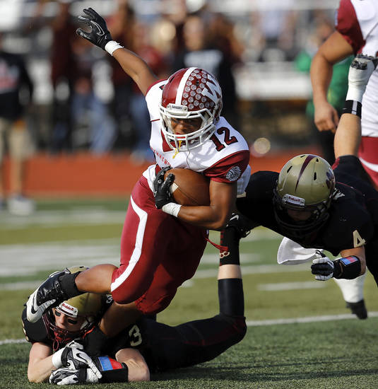 Wynnewood runningback Curtis Rushinhg is brought down by Cashion tacklers Hunter Suntken, left, and Peyton Maroney. Cashion vs. Wynnewood at Norman in a Class A semifinal football game, Saturday, Dec. 1, 2012.     Photo by Jim Beckel, The Oklahoman