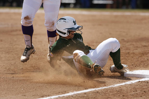 USF's Ashli Goff (2) slides in to third base past LSU's Tammy Wray (18) during a Women's College World Series game between Louisiana State University and the University of South Florida at ASA Hall of Fame Stadium in Oklahoma City, Saturday, June 2, 2012.  Photo by Garett Fisbeck, The Oklahoman