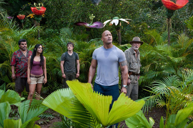 "From left, Luis Guzman, Vanessa Hudgens, Josh Hutcherson, Dwayne Johnson and Michael Caine encounter the unexpected in �Journey 2: The Mysterious Island."" WARNER BROS. PICTURES PHOTO"