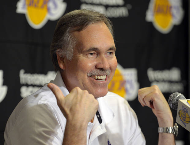Los Angeles Lakers head coach Mike D'Antoni speaks during a news conference before their NBA basketball game against the Houston Rockets, Sunday, Nov. 18, 2012, in Los Angeles. (AP Photo/Mark J. Terrill)