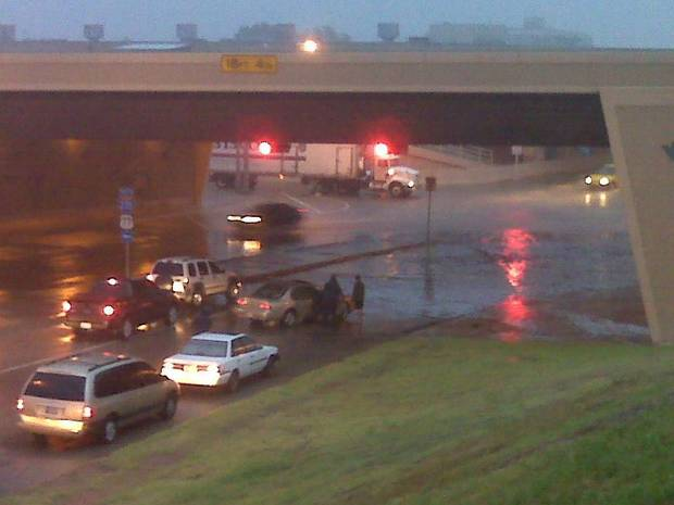 Motorists stranded under the Broadway Extension bridge at NW 36. Photo by Robert Medley