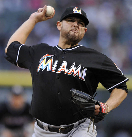 Miami Marlins starter Ricky Nolasco delivers a pitch during the first inning of a baseball game against the Chicago White Sox in Chicago, Saturday, May 25, 2013. (AP Photo/Paul Beaty)