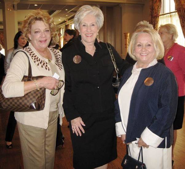 GATHERING OF ANGELS....Barbara Beeler, Nancy Ellis and Linda Reece check out the raffle items. (Photo by Helen FOrd Wallace).