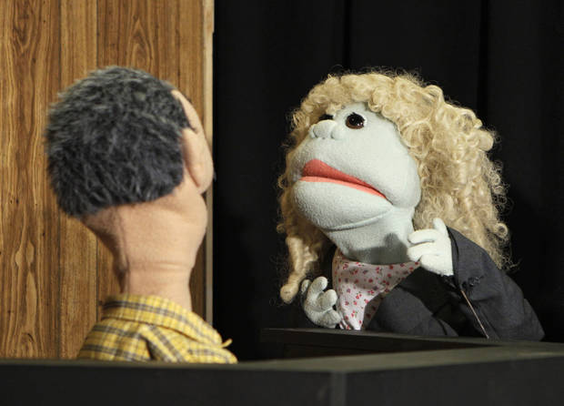 A puppet representing defense attorney Andrea Whitaker cross-examines a Ferris Kleem puppet during taping at WOIO-TV in Cleveland Thursday, Jan. 19, 2012. The station uses the puppets performing as witnesses, reporters and jurors to detail the corruption trial against former Cuyahoga county commissioner Jimmy Dimora, which began last week in federal court in Akron. (AP Photo/Mark Duncan)