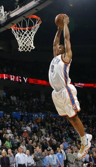 Russell Westbrook (0) of Oklahoma City dunks the ball during the NBA basketball game between the Oklahoma City Thunder and the New York Knicks at the Ford Center in Oklahoma City, January 11, 2010. Photo by Nate Billings, The Oklahoman
