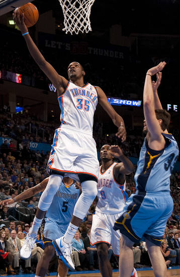 Oklahoma City's Kevin Durant (35) goes past Memphis' Marc Gasol (33) during the NBA game between the Oklahoma City Thunder and the Memphis Grizzlies at Chesapeake Energy Arena in Oklahoma CIty, Friday, Feb. 3, 2012. Photo by Bryan Terry, The Oklahoman