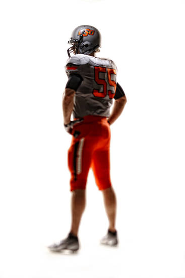 Oklahoma State's new football uniforms. Pictured here are the orange pants, silver jersey and silver helmet. PHOTO PROVIDED