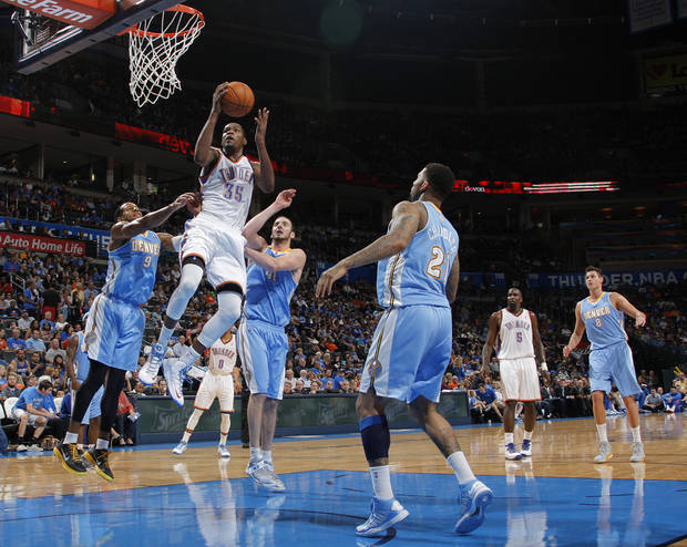 Oklahoma City's Kevin Durant (35) goes up for a shot during the NBA preseason basketball game between the Oklahoma City Thunder and the Denver Nuggets at the Chesapeake Energy Arena, Sunday, Oct. 21, 2012. Photo by Garett Fisbeck, The Oklahoman