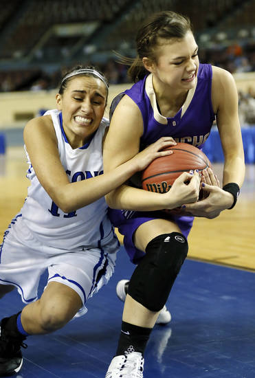 Turner's Taylor Foster (11), left, and Okarche's Madison Lee (24) battle for the ball during a Class A Girls semifinal game of the state high school basketball tournament between Okarche and Turner at Jim Norick Arena, The Big House, on State Fair Park in Oklahoma City, Friday, March 1, 2013. Photo by Nate Billings, The Oklahoman