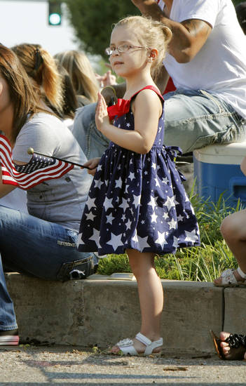 Four year old Violet Iver waves to a parade entry during the annual LibertyFest Fourth of July Parade in downtown Edmond, OK, Thursday, July 4, 2013,  Photo by Paul Hellstern, The Oklahoman