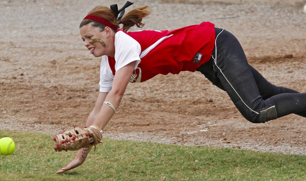 HIGH SCHOOL SOFTBALL TOURNAMENT: Washington's Tymber Howard (10) misses the catch as she dives for the ball during the Oklahoma State Softball tournament game between Washington and Sulphur at ASA Hall of Fame Stadium on Thursday, Oct. 4, 2012, in Oklahoma City, Okla.   Photo by Chris Landsberger, The Oklahoman