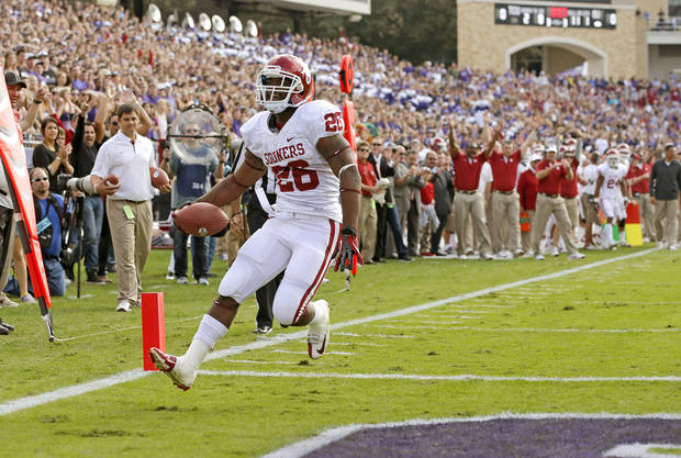 Oklahoma&#039;s Damien Williams (26) scores during a college football game between the University of Oklahoma Sooners (OU) and the Texas Christian University Horned Frogs (TCU) at Amon G. Carter Stadium in Fort Worth, Texas, Saturday, Dec. 1, 2012. Oklahoma won 24-17. Photo by Bryan Terry, The Oklahoman