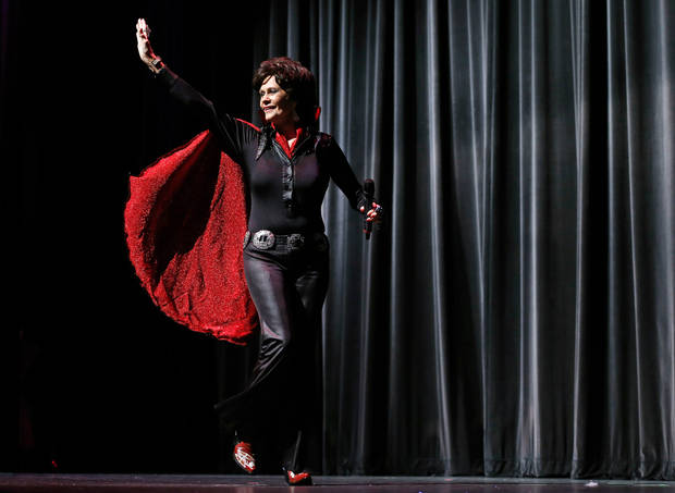 Dawn Anita Plumlee of Duncan waves to the crowd after performing as Lady Elvis  during the talent portion of the Ms. Oklahoma Senior America Pageant. Photo by Bryan Terry, The Oklahoman