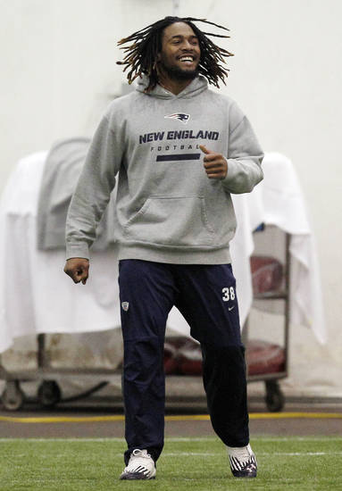 New England Patriots running back Brandon Bolden, currently on a one week roster exemption, is back from his four game suspension for violating the NFL's policy on performance enhancing substances as the team walks into the practice dome at their NFL football training facility in Foxborough, Mass., Wednesday, Dec. 5, 2012. (AP Photo/Stephan Savoia)