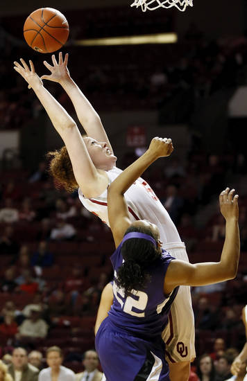 Oklahoma's Joanna McFarland (53) grabs a rebound against Kansas State's Mariah White (22) during an NCAA women's college basketball game between the University of Oklahoma (OU) and Kansas State at Lloyd Noble Center in Norman, Okla., Wednesday, Feb. 20, 2013. Photo by Nate Billings, The Oklahoman