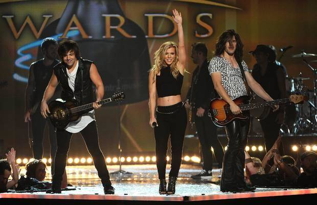 Vocal group of the year winners Neil Perry, left, Kimberly Perry and Reid Perry, of the musical group The Band Perry, perform at the 49th annual Academy of Country Music Awards at the MGM Grand Garden Arena on Sunday, April 6, 2014, in Las Vegas. (AP)