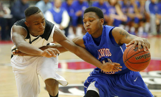 Millwood's Chris Cook, at right, tries to get past Hugo's Trey Johnson during a Class 3A boys state basketball tournament game between Hugo and Millwood at Yukon High School in Yukon, Okla., Thursday, March 7, 2013. Photo by Bryan Terry, The Oklahoman