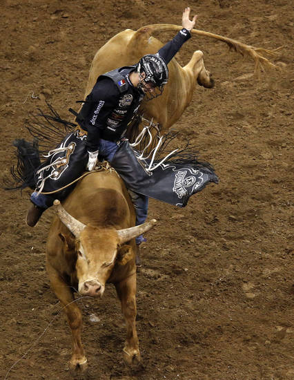 Aaron Roy rides Cowtown Slinger during the WinStar World Casino Invitational PBR bull riding event at Chesapeake Energy Arena in Oklahoma City,  Sunday, Jan. 27, 2013.Photo by Sarah Phipps, The Oklahoman