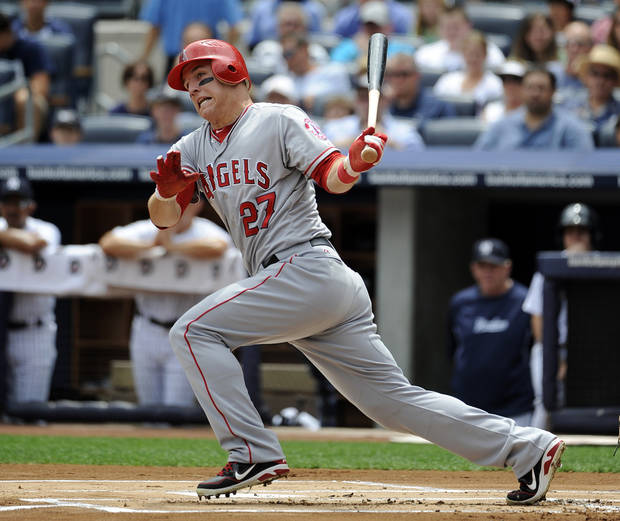   FILE - This July 14, 2012 file photo shows Los Angeles Angels&#039; Mike Trout (27) hiting a single off of New York Yankees relief pitcher Freddy Garcia in the first inning of a baseball game at Yankee Stadium in New York. Trout is favored to win AL Rookie of the Year, Monday, Nov. 12, 2012.(AP Photo/Kathy Kmonicek, File)  