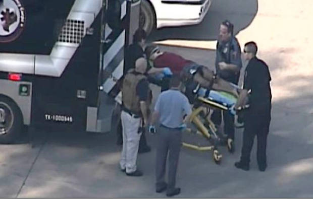 In this frame grab provided by KPRC Houston, an unidentified person is transported by emergency personnel at Lone Star College Tuesday, Jan. 22, 2013, in Houston, where law enforcement officials say the community college is on lockdown amid reports of a shooter on campus.  (AP Photo/Courtesy KPRC TV) MANDATORY CREDIT ORG XMIT: CER106