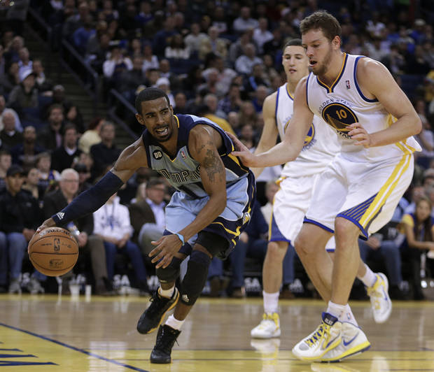 Memphis Grizzlies' Mike Conley, left, drives the ball past Golden State Warriors' David Lee during the first half of an NBA basketball game Wednesday, Jan. 9, 2013, in Oakland, Calif. (AP Photo/Ben Margot)