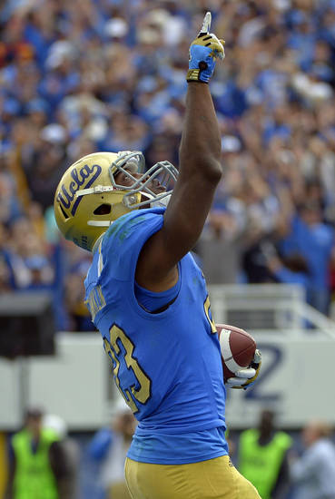 UCLA running back Johnathan Franklin celebrates after scoring a touchdown during the first half of their NCAA college football game against USC, Saturday, Nov. 17, 2012, in Pasadena, Calif. (AP Photo/Mark J. Terrill)
