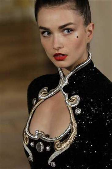 Red lips on the runway for the Bouchra Jarrar spring 2013 haute couture show in Paris. AP PHOTO