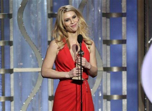 "This image released by NBC shows Claire Danes with her award for best actress in a TV drama series for her role in ""Homeland"" during the 70th Annual Golden Globe Awards at the Beverly Hilton Hotel on Jan. 13, 2013, in Beverly Hills, Calif. (AP Photo/NBC, Paul Drinkwater)"