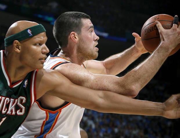 Nick Collison of Oklahoma City fights with Charlie Villanueva of Milwaukee during the opening NBA basketball game between the Oklahoma City Thunder and the Milwaukee Bucks at the Ford Center in Oklahoma City, Wednesday, October 29, 2008.  BY BRYAN TERRY, THE OKLAHOMAN