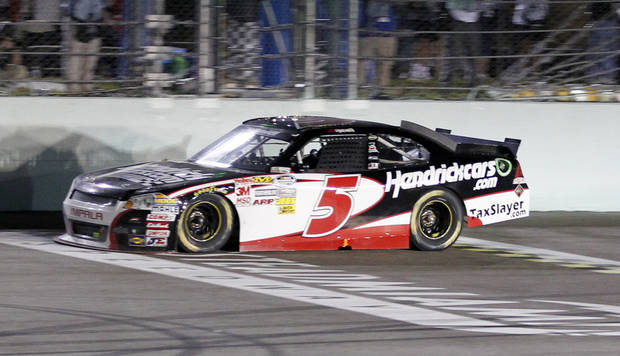Driver Regan Smith crosses the finish line to win the NASCAR Nationwide Series auto race at Homestead-Miami Speedway Saturday, Nov. 17, 2012 in Homestead, Fla. (AP Photo/Terry Renna)