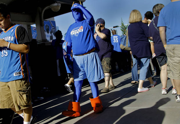 Thunder fan Chris Zoski walks Thunder Alley before the start of the game 3 of the Western Conference Finals of the NBA basketball playoffs between the Dallas Mavericks and the Oklahoma City Thunder at the OKC Arena in downtown Oklahoma City, Saturday, May 21, 2011. Photo by Chris Landsberger, The Oklahoman