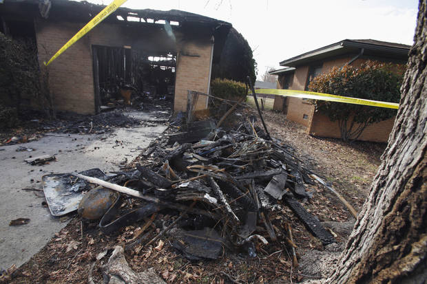 HOUSE FIRE: Damage from a fire shows at 1316 Sunset Drive on Thursday, Dec. 22, 2011, in Norman, Okla.   Photo by Steve Sisney, The Oklahoman