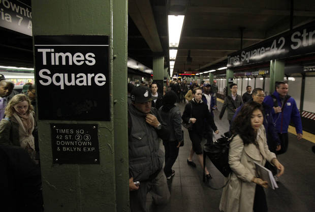 Passengers exit a downtown-bound, west side subway train in New York's Times Square,  Thursday, Nov. 1, 2012.  New York City moved closer to resuming its frenetic pace by getting back its vital subways Thursday, three days after a superstorm, but neighboring New Jersey was stunned by miles of coastal devastation and the news of thousands of people in one city still stranded by increasingly fetid flood waters.  (AP Photo/Richard Drew) ORG XMIT: NYRD104