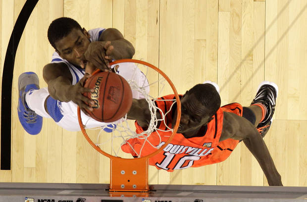 Kentucky forward Michael Kidd-Gilchrist (14) slam dunks over Louisville center Gorgui Dieng (10) during the second half of an NCAA Final Four semifinal college basketball tournament game Saturday, March 31, 2012, in New Orleans. Kentucky won 69-61.(AP Photo/Mark Humphrey)
