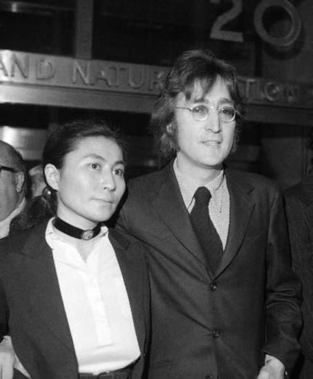 In this March 16, 1972 photo, John Lennon and Yoko Ono leave a brief deportation hearing in New York at the offices of the Department of Immigration and Naturalization. Ono celebrated her 80th birthday on Feb. 18. (AP file)